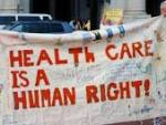 "Banner held in a march reads, ""Health Care is a Human Right"""