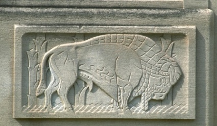 architectural detail: buffalo with mane and lines of the body grooved