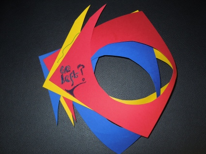 Red Blue yellow paper cut with oval in center of each, overlapped, with