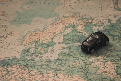 map showing europe and asia with toy car on it