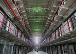 smart decarceration image of prison walkway with cells bars