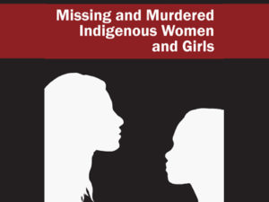 "Balck Sqaure with two profiles silhouetted. Red band at top says ""Missing adn Murdered Indigenous Women and Girls"""