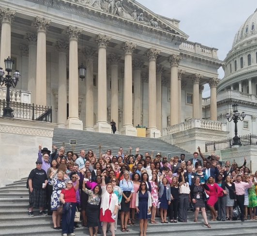 Group photo of NASW Voter Engagement Teach-in participants on steps of the Capito