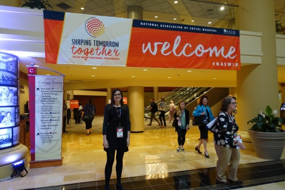 Cerruti stands under welcome banner to #NASW18