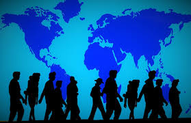 World map in blue as background with silouhettes of alin eof people walking in front of it