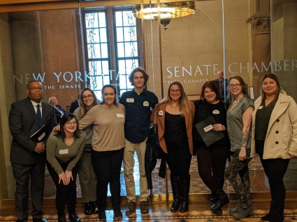 A group of University at Buffalo MSW students pose in front of the entrance to the New York Sate Senate Chambers in the Capitol, Albany, NY.